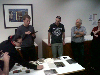 Getting hands-on with photographs. Image courtesy of Sally August.