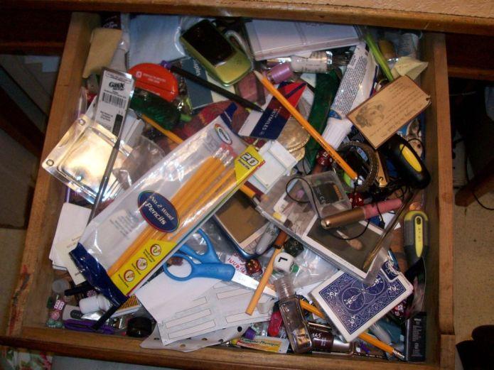 cluttered desk drawer