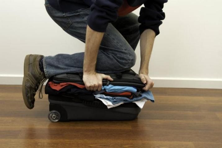Think about what you're actually going to use, and pack those things first. Then check yourself. Do you really need 10 pairs of jeans, 10 t-shirt, 2 pairs of shoes... Bring only the stuffs that you are going to use and think about the stuffs that you are going to buy during your holidays.