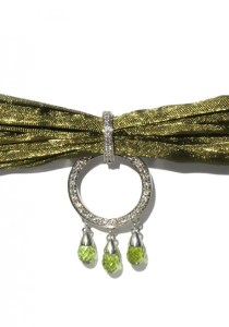 Calgaro Peridot, Diamond Green Silk & Silver Enhancer | Oster Jewelers Blog