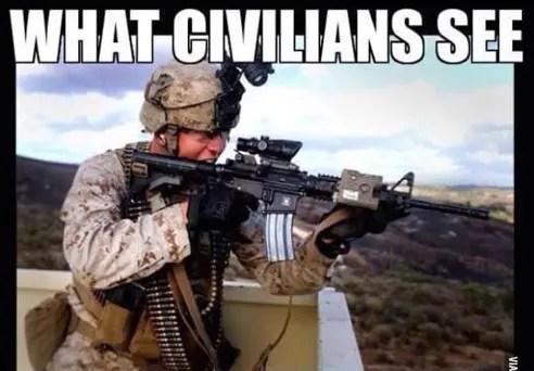 Marine in battle gear firing weapon from rooftop