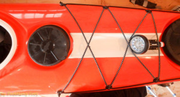 """Compass installed on the deck of the Beaufort. Fit is snug. The installation hardly interferes with deck bungee fittings. Actually the bungees ensure that the compass will not become dislodged by """"accident"""""""