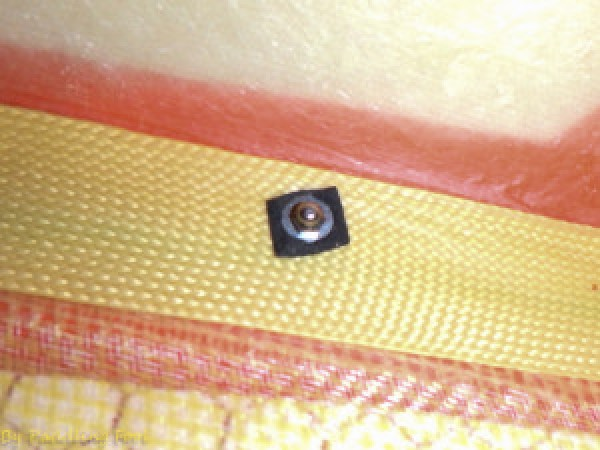 """The """"inside workings"""" of the sidestay hardpoint. Here additional re-inforcement was /isnt required.. as the hole goes thru the Kevlar tape!"""
