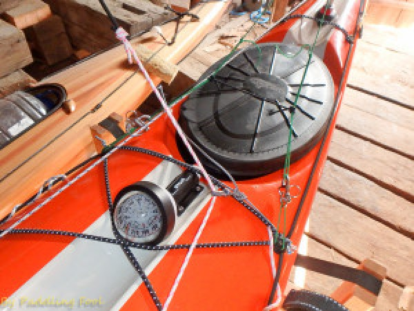 """On two previous installations I have used a thru-padeye installed on the deck centrally fro the sheet pulley, this usually requires two thru deck holes! I cringe at every etra hole I drill thru the deck. One previous installation I tried a pad-eye styled pulley, it seems to work so I decided to try it with the Beaufort installation. Another consideration for this choice was the compass installation which prettymuch rules out a """"central installation! Here pictured I have replaces the pulley with a 4mm SS thimble which has been jury rigged with a Prusik styled knot onto another 4mm dyneemaline (darkblue/white) running across the deck. The idea is to find a working position for the """"pulley/thimble"""" line so that the sheet line will not snag onto the compass.. (yes sounds complex..)"""