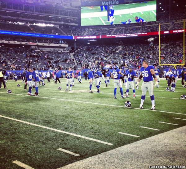 The New York Giants warm up on the opposite side of the field