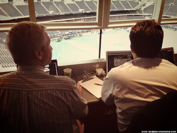 Packers.com's Vic Ketchman and Mike Spofford look on from the Soldier Field press box