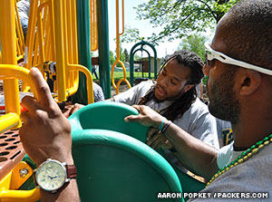 RB Alex Green and CB Jarrett Bush help assemble a playground