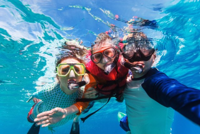 A family snorkels together