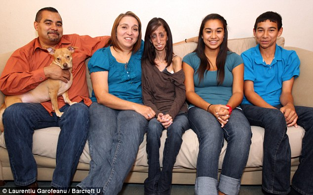 lizzie-with-her-supportive-parents-lupe-and-rita-and-protective-younger-siblings