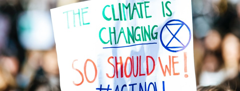the climate is changing signage