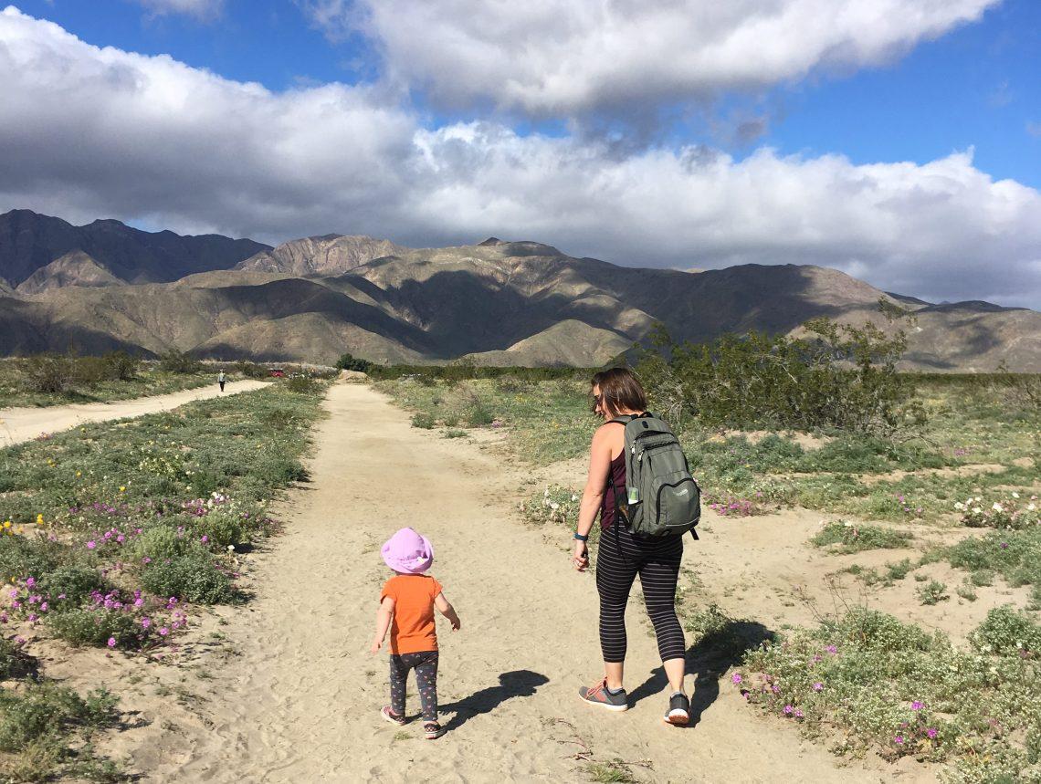 Megan and child walking along sandy trail