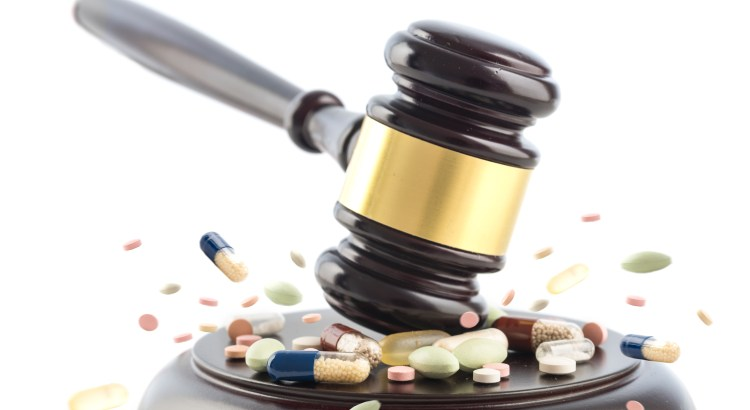 Image of gavel smashing pills