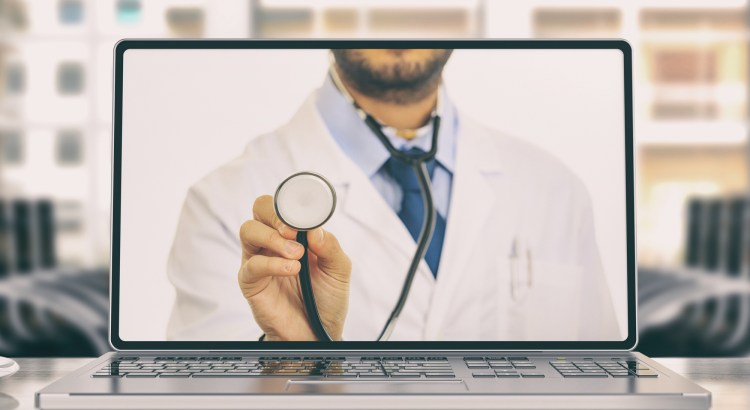 Image of a laptop showing a doctor holding a stethoscope. Telemedicine abstract.
