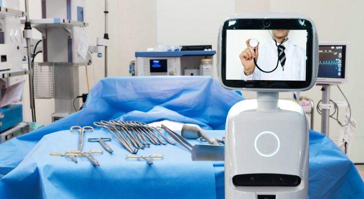 Image of a surgery room with a robot whose screen has a doctor with a stethoscope