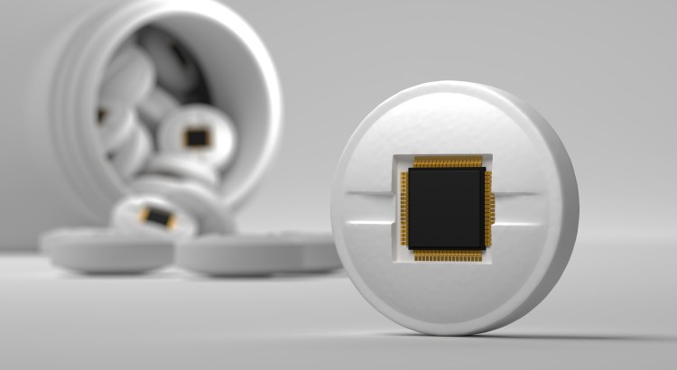 Illustration of a pill with a sensor embedded