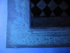 3. DT Adhesive residue fluoresced under UV visible illumination.
