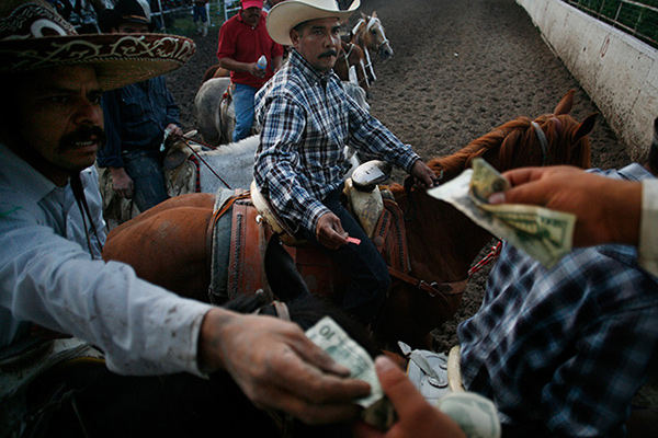 Photo by Julia Robinson Charros pay cash for Coleadero""