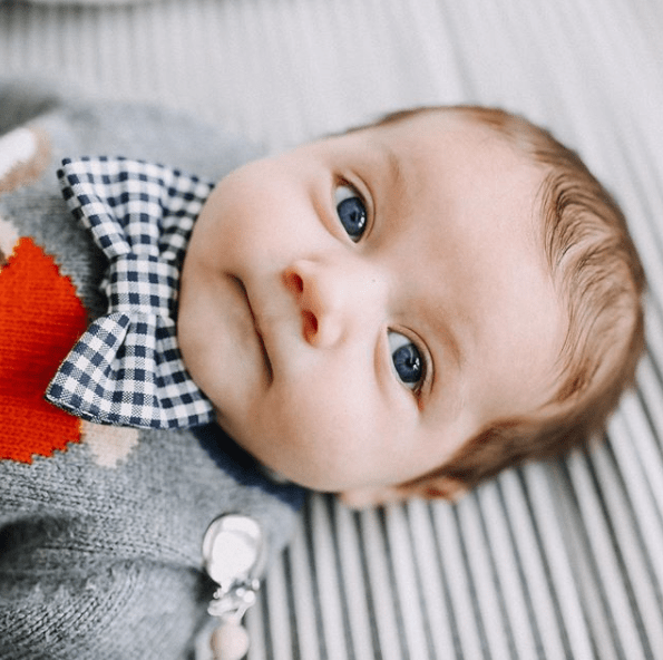 little boy with blue eyes with a big bow tie