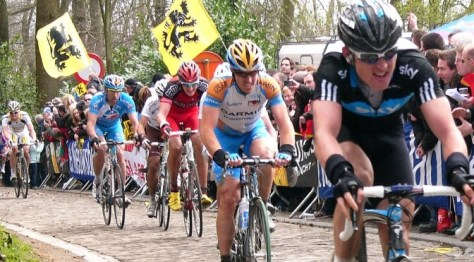 Cyclists riding on cobbles