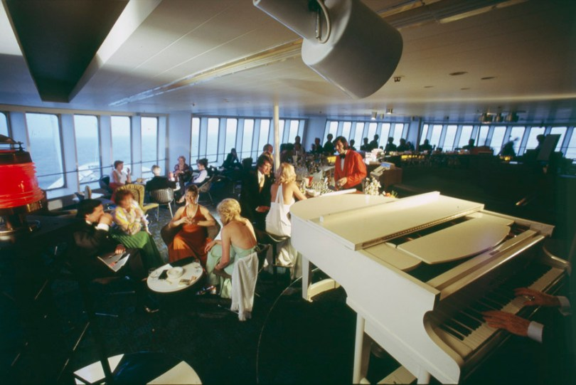 A piano in the dining room of a P&O ship in the 1980s