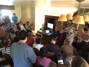 Onshape's demo at COFES 2015 drew crowds. Image from Onshape. That's me on the left in the white and blue striped shirt.