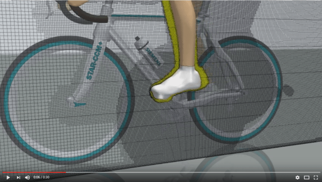 Screen capture from a [very nice] video visualization of a STAR-CCM+ simulation of a bicycle and rider. Click image for video.