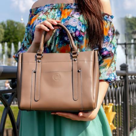 Women holding a brown handbag
