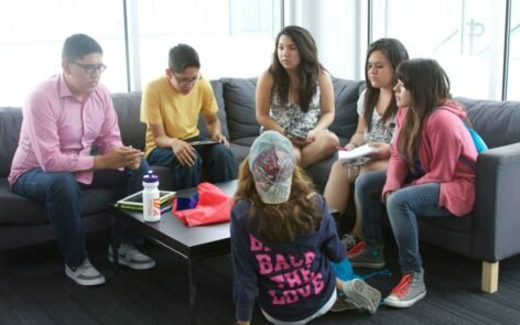 Teens participate in discussions, hands-on activities, and interactive presentations.