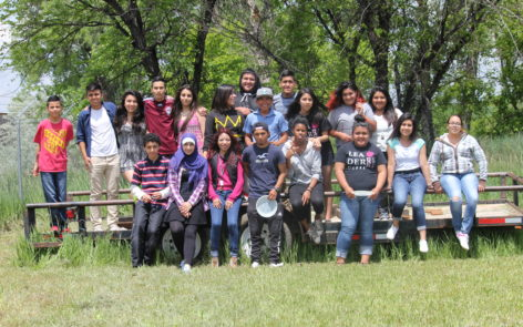 Past Imaginantes participants gather during one of their field trips.