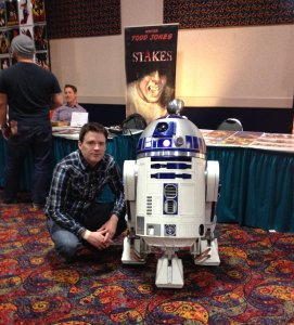 """Todd Jones, creator of the comic book """"Stakes,"""" in a recent appearance with R2D2."""
