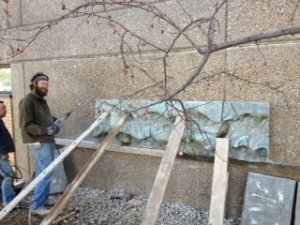 The river wall artwork being installed