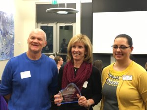 Anne Macdonald (center) pictured with Mike O'Connell, SBDC director, and Kat Rico.