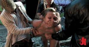 Beautiful girl is tied up in rope and fucked by strangers in public