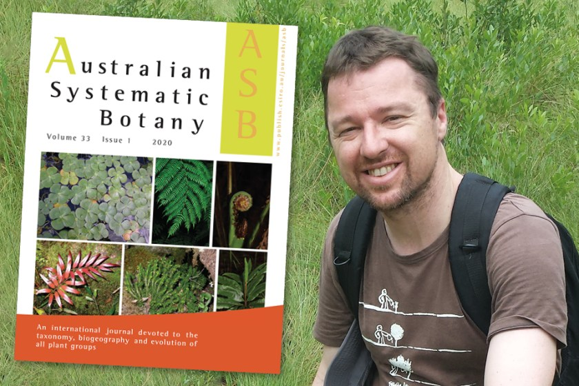 Dr Daniel Murphy standing in front of green grass with a superimposed image of the cover of Australian Systematic Botany next to him.
