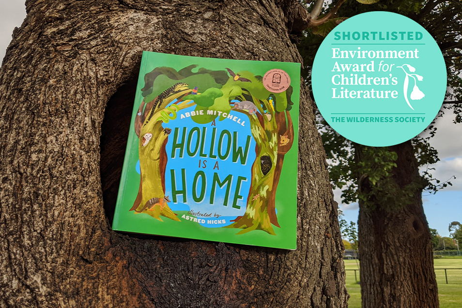 A Hollow is a Home book situated in a tree hollow with award logo placed in right hand corner
