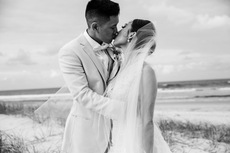 bride-wearing-george-wu-and-groom-on-beach-elements-of-byron-bay-quincenmulberry