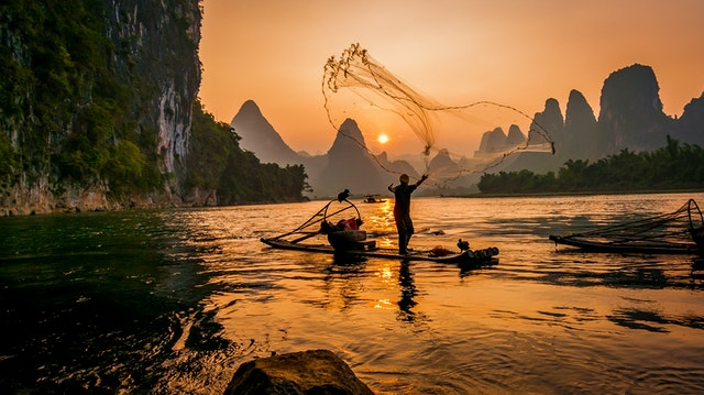 person-s-on-boat-throwing-fishing-net-3054187