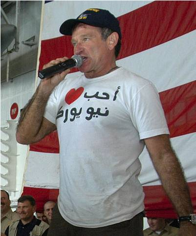 Robin Williams, wearing a shirt that says, 'I love New York ' in Arabic.
