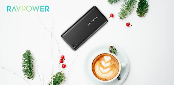 Power bank flatlay next to a cup of coffee and Christmas decor