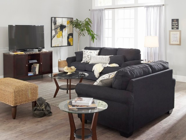 Black loveseat and sofa set in modern living room