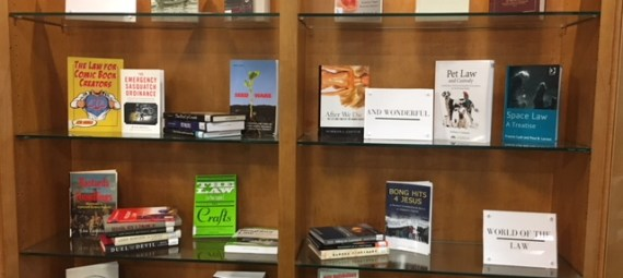 Display of books on various legal topics in a glass case