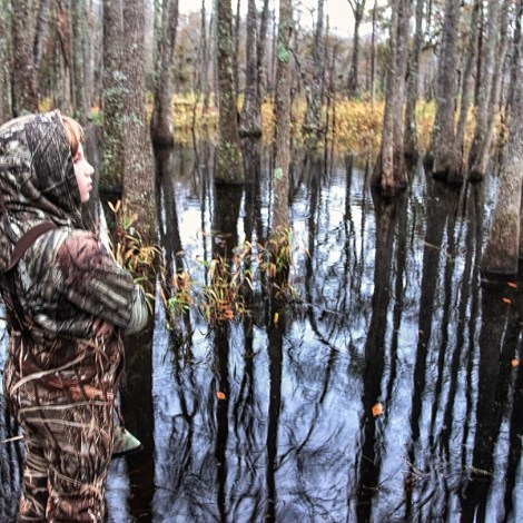 Waiting for wood ducks in the swamp.