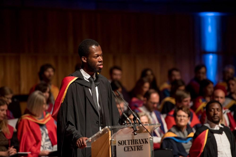 Chuchu Nwagu gives his inaugural speech as Matt Henry looks on