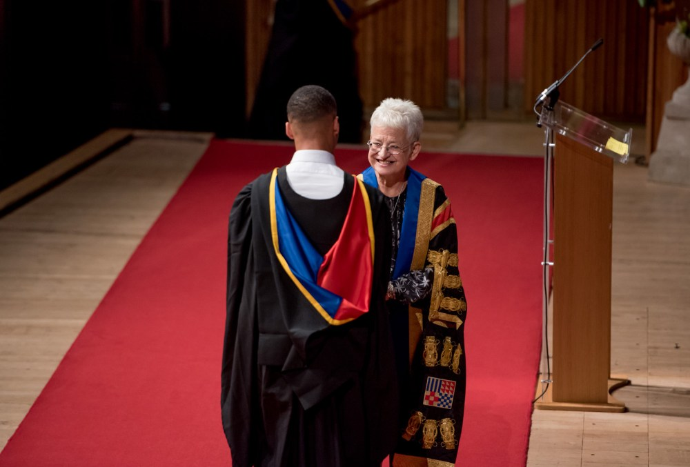 Chancellor Jacqueline Wilson shakes hands with a graduate
