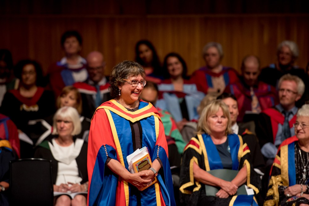 Yasmin Alibhai-Brown, smiles as she receiving her honorary doctorate
