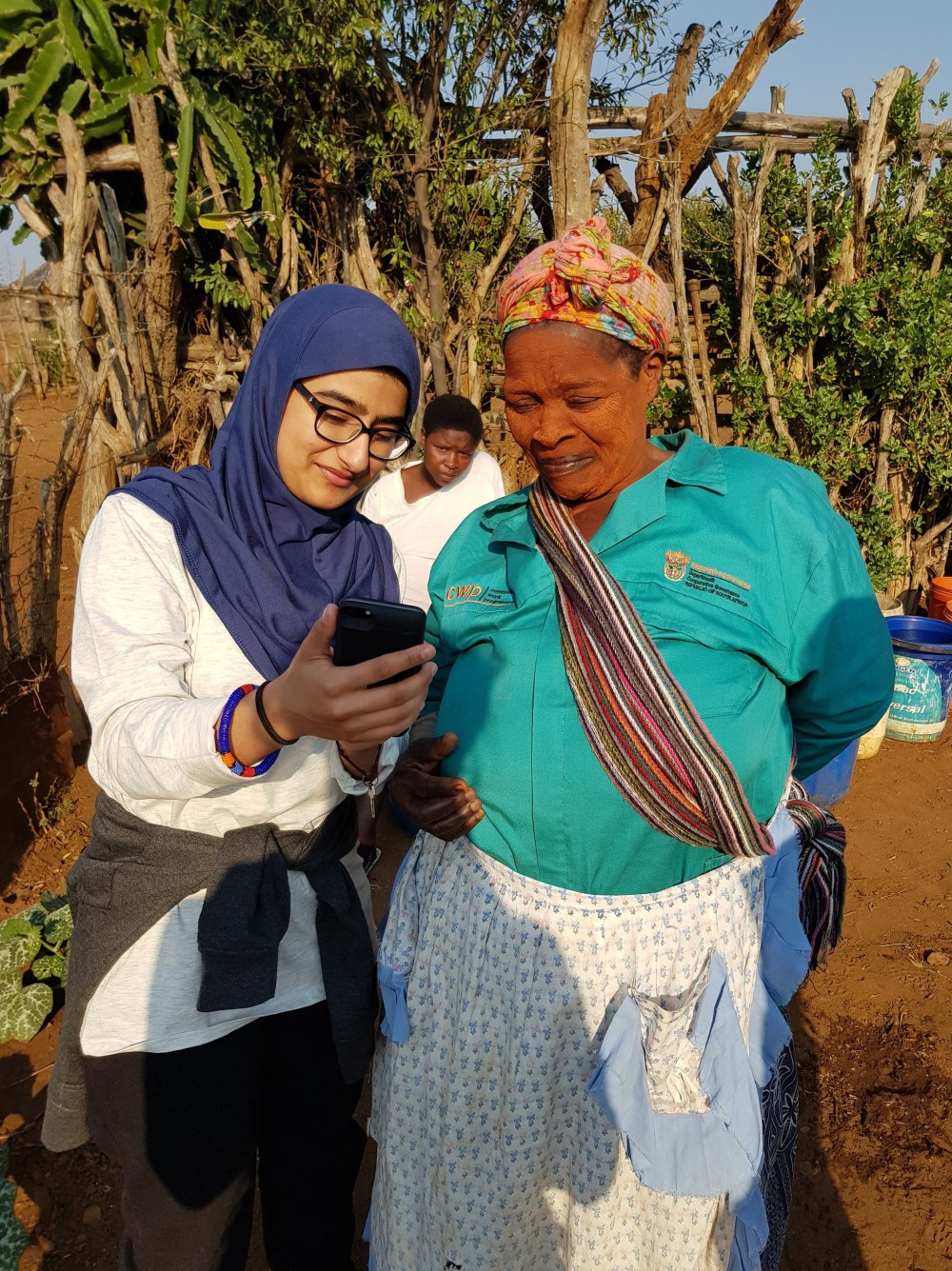 A young woman showing an older woman something on her phone