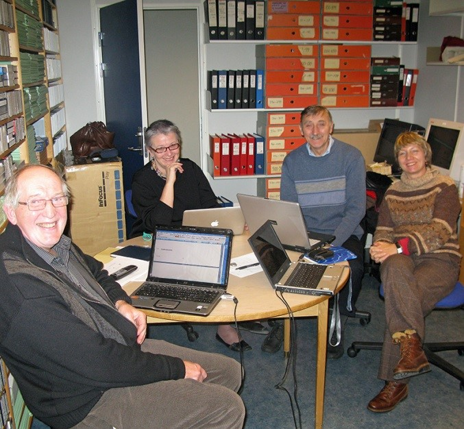 Four academics in an office