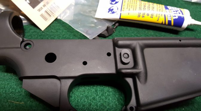 Assembling an AR Lower – Step 1 of 11:  Installing the Magazine Catch Assembly
