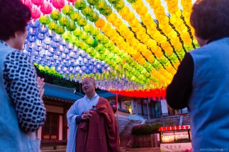 A Buddhist monk welcomes visitors during a small celebration of Buddha's birthday in South Korea ISO 1600 Yonghwasa (용화사) Temple Tongyeong, South Korea