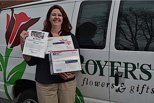 "Dena Eberhart, Royer's human resources manager, with packages filled with cards and letters for ""Holiday Mail for Heroes"" program."